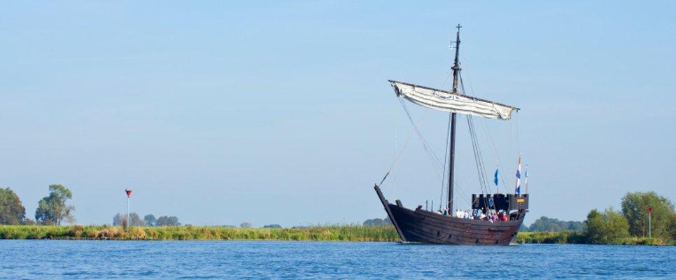 Historic Kamper Kogge sailing ship on the river IJssel.